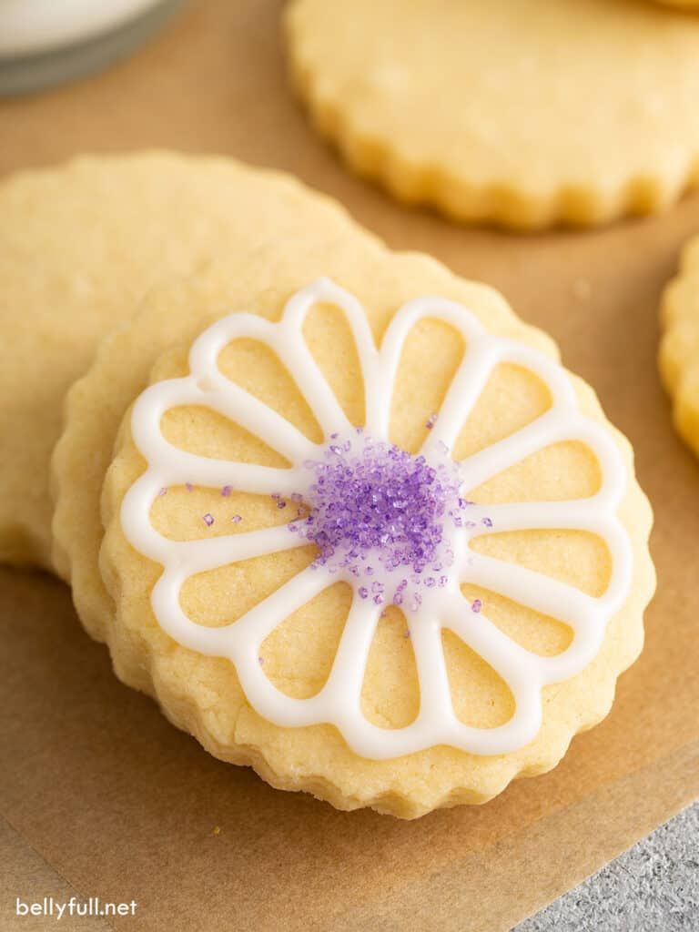 cut out sugar cookie iced with flower decoration
