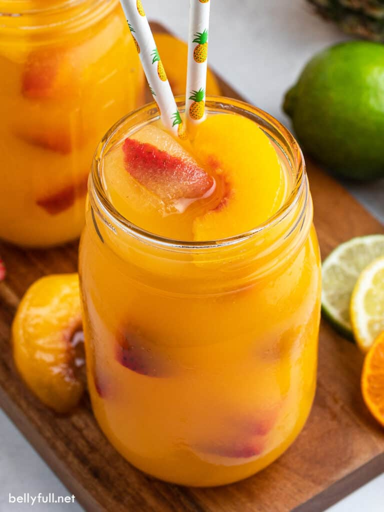 fruit punch in mason jar with decorative pineapple straws