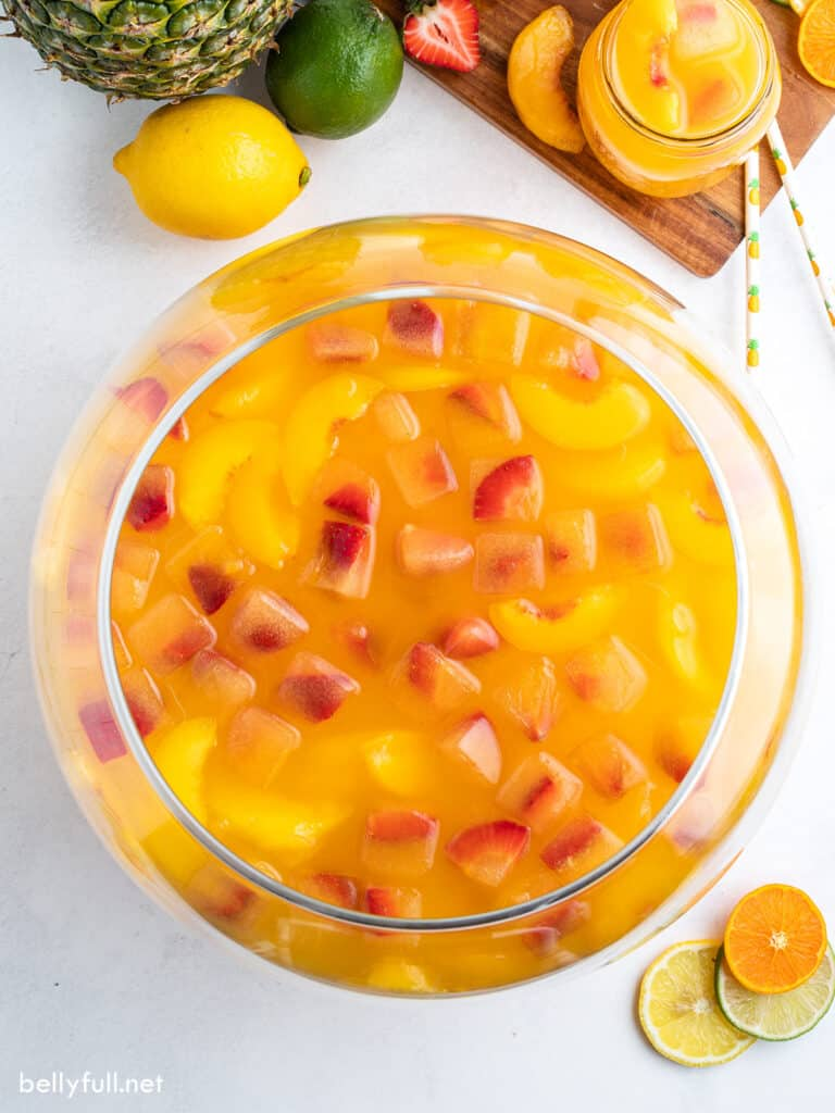overhead punch bowl filled with fruit punch and strawberry fruit ice cubes