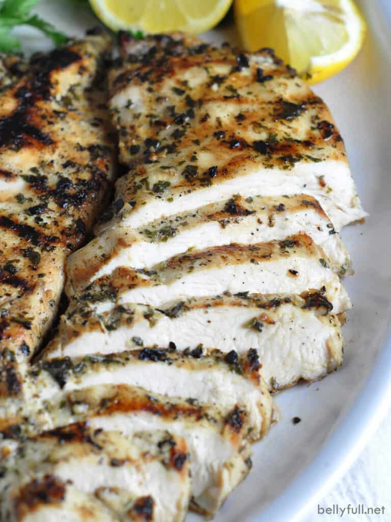 sliced grilled chicken breast on plate