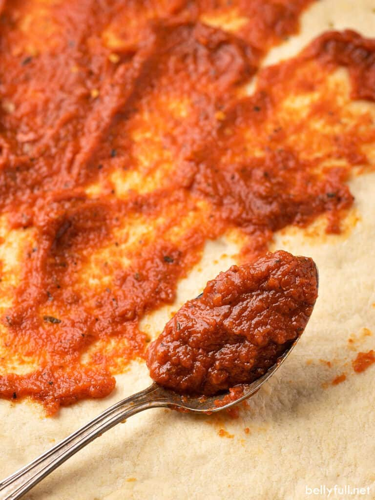 close up image of spoonful of pizza sauce