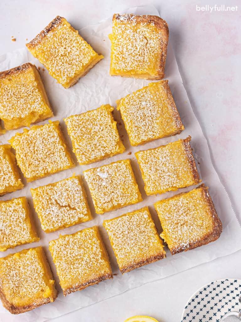 overhead cut lemon bar squares on parchment paper