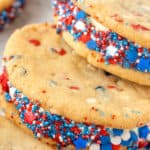 close up cookie ice cream sandwich rolled in red white blue sprinkles