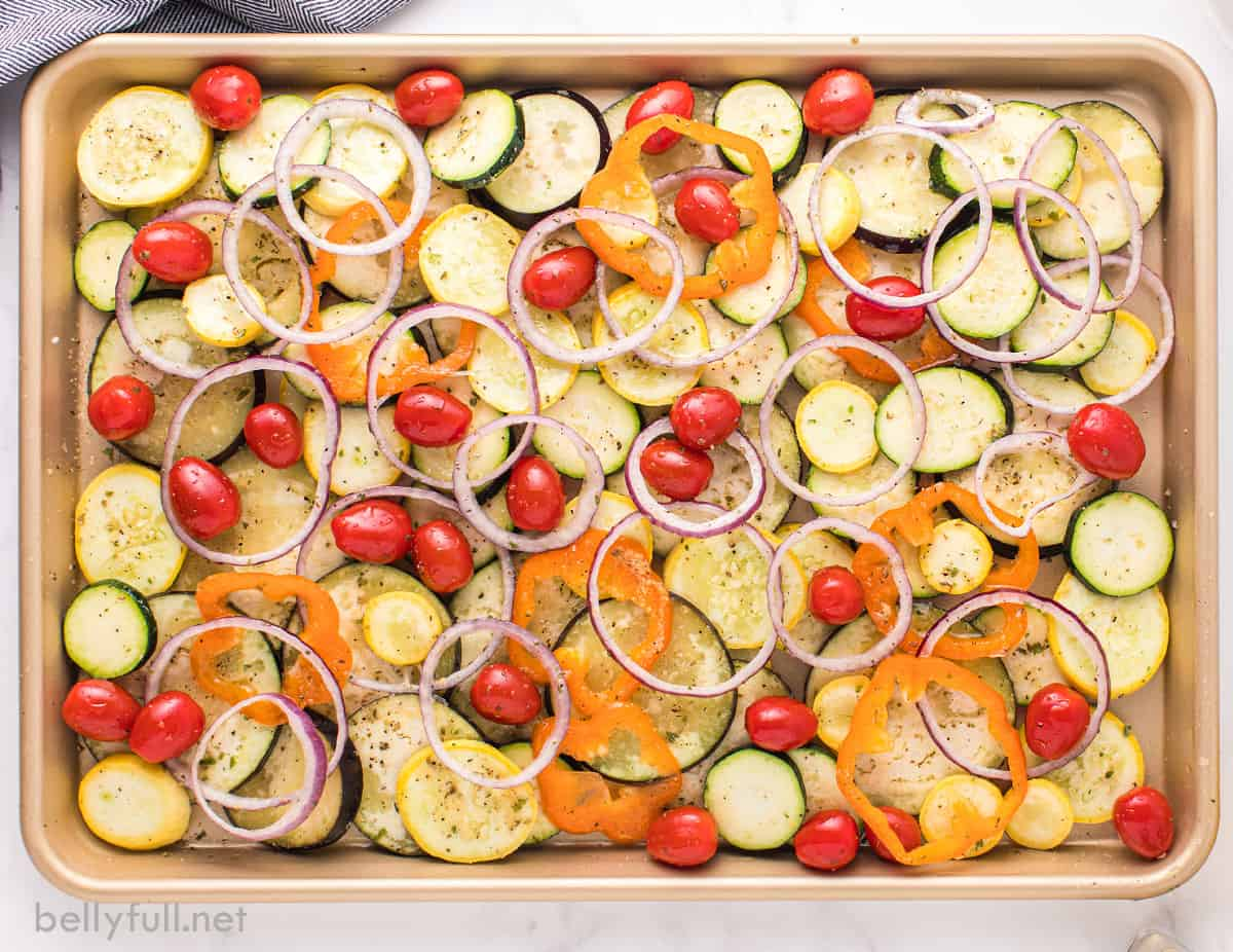 The vegetables for ratatouille sliced on a baking sheet