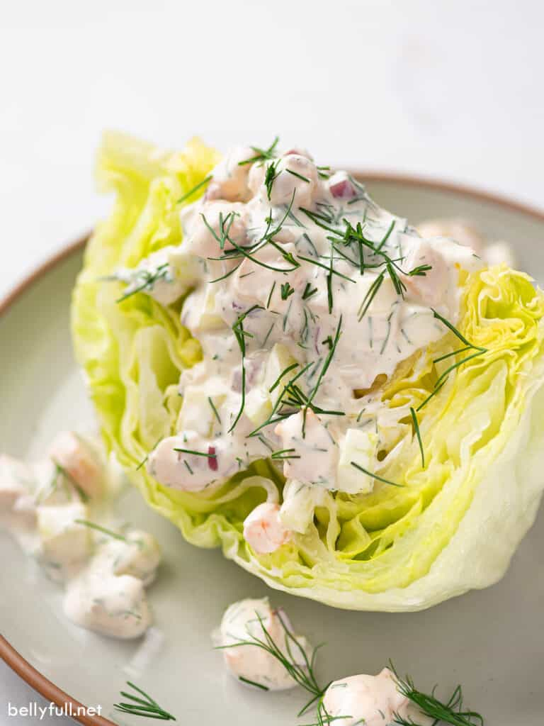 iceberg wedge salad with creamy shrimp dressing on plate