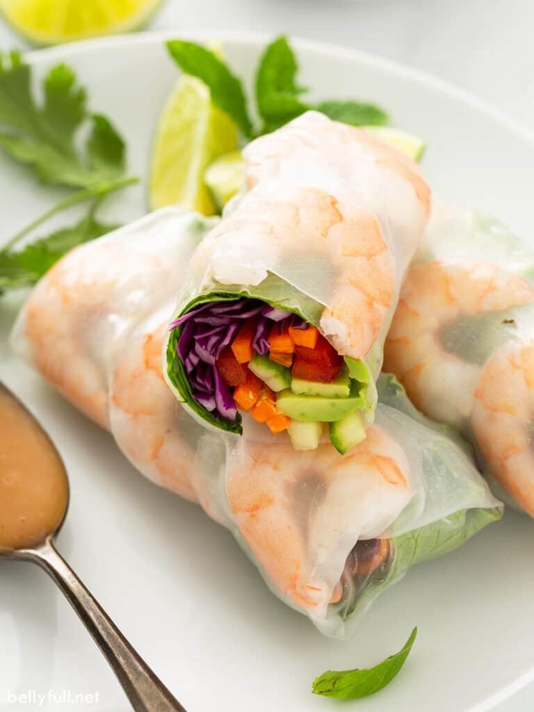 shrimp spring rolls cut in half on top of 2 more rolls