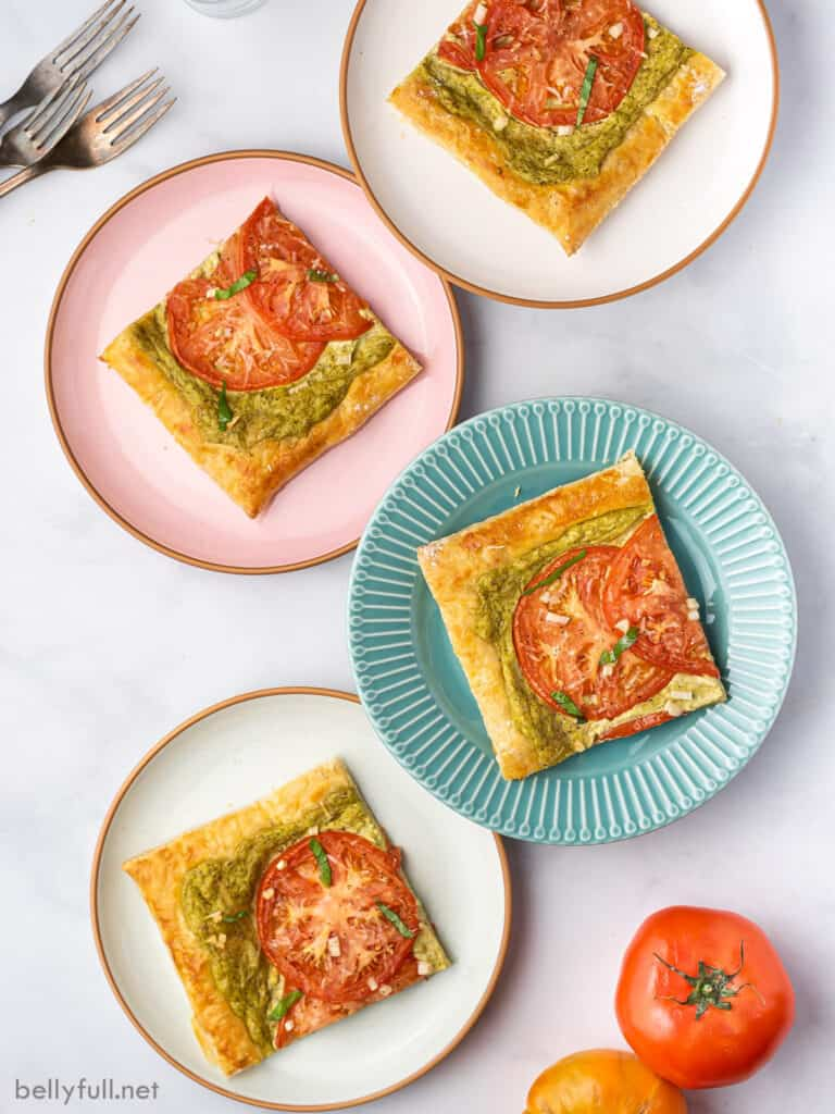 4 colored plates with a slice of baked puff pastry tart