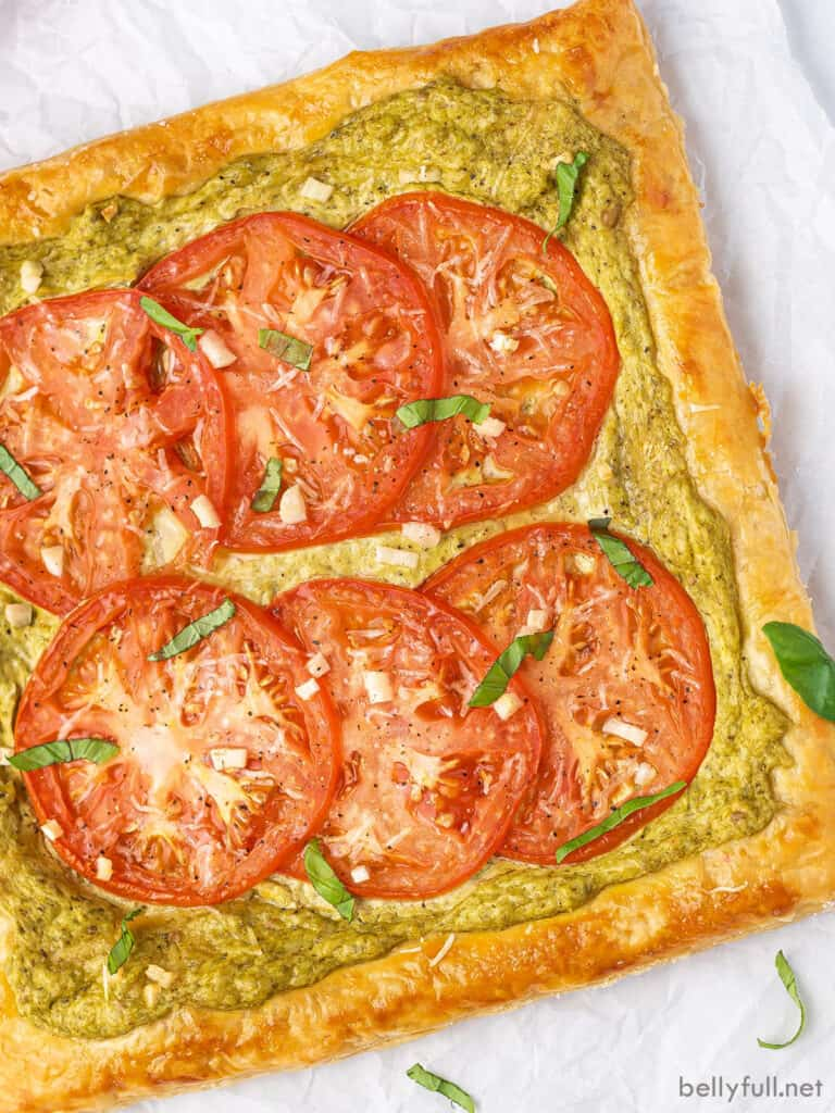 overhead baked tomato tart on parchment paper