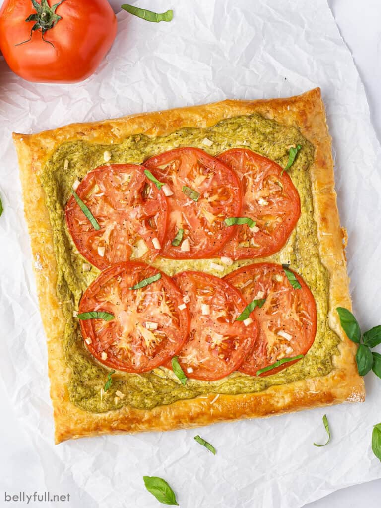 overhead whole tomato tart on parchment paper