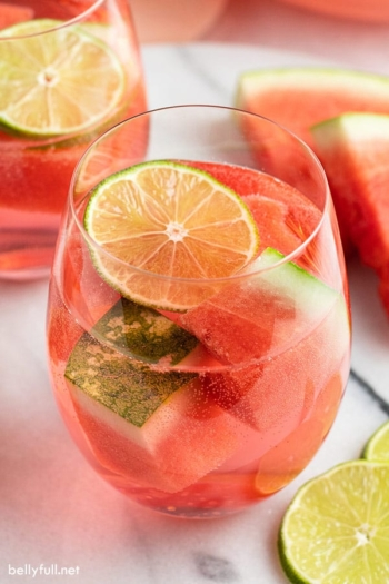 glass filled with watermelon sangria and lime slice