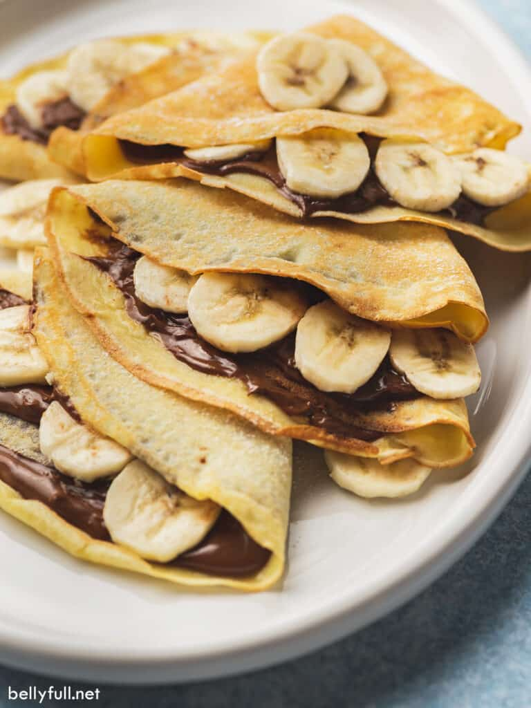 close up crepes stuffed with nutella and sliced banana