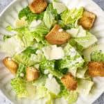 overhead Caesar Salad on white plate