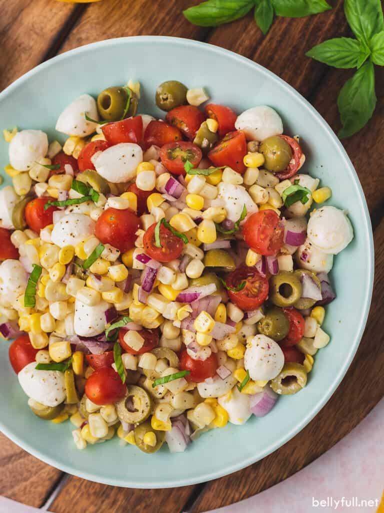 overhead caprese corn salad in serving bowl