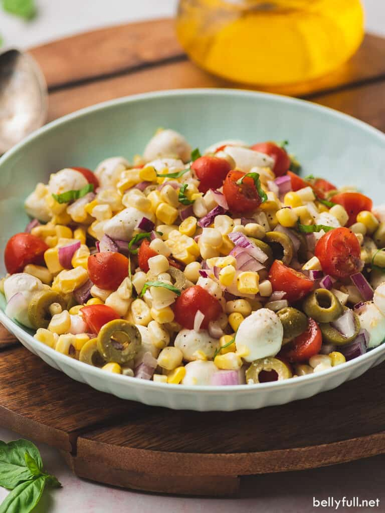 corn salad with cherry tomatoes and green olives