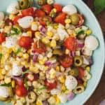 close up overhead caprese corn salad in serving bowl