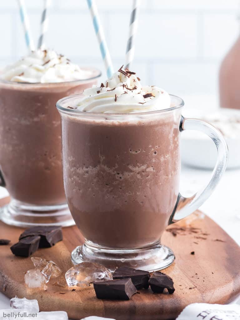 chocolate frosty drink in glass with whipped cream