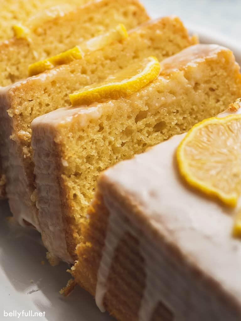 close up slice of lemon cake with icing