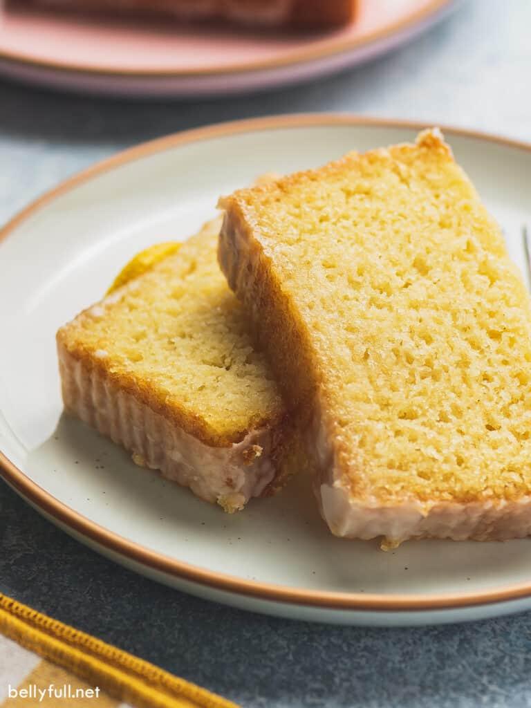 2 slices of iced lemon pound cake on plate