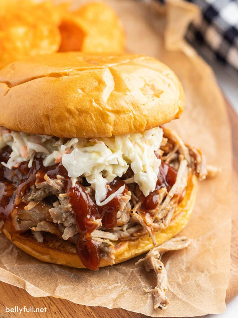pulled pork sandwich with coleslaw and BBQ sauce