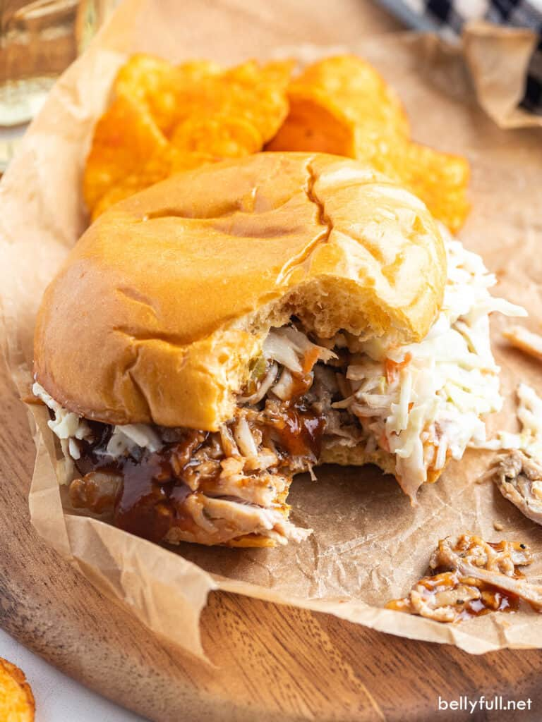 shredded pork sandwich with bite taken