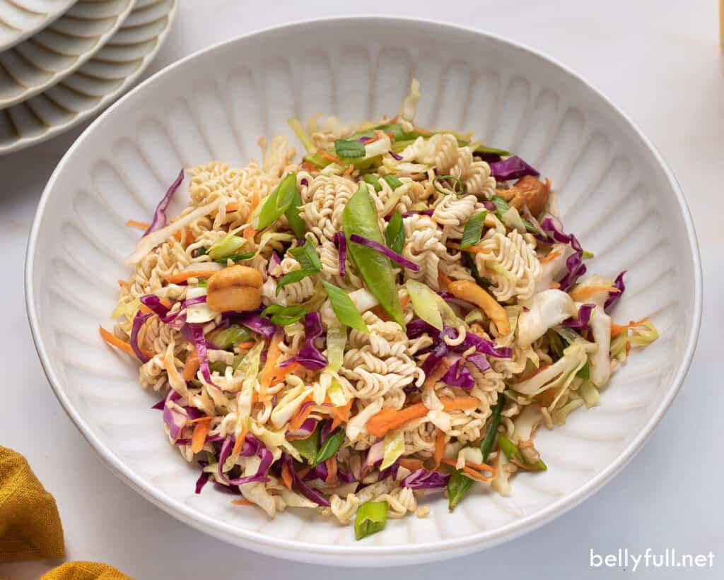 portion of ramen cabbage salad in white bowl