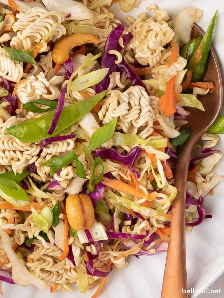 close up asian cabbage salad with chunks of dry ramen noodles