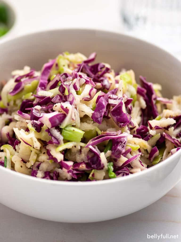 white bowl of red cabbage slaw