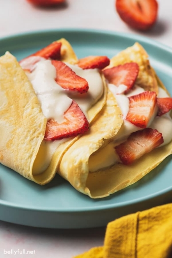 strawberry crepes with cream filling and fresh sliced strawberries
