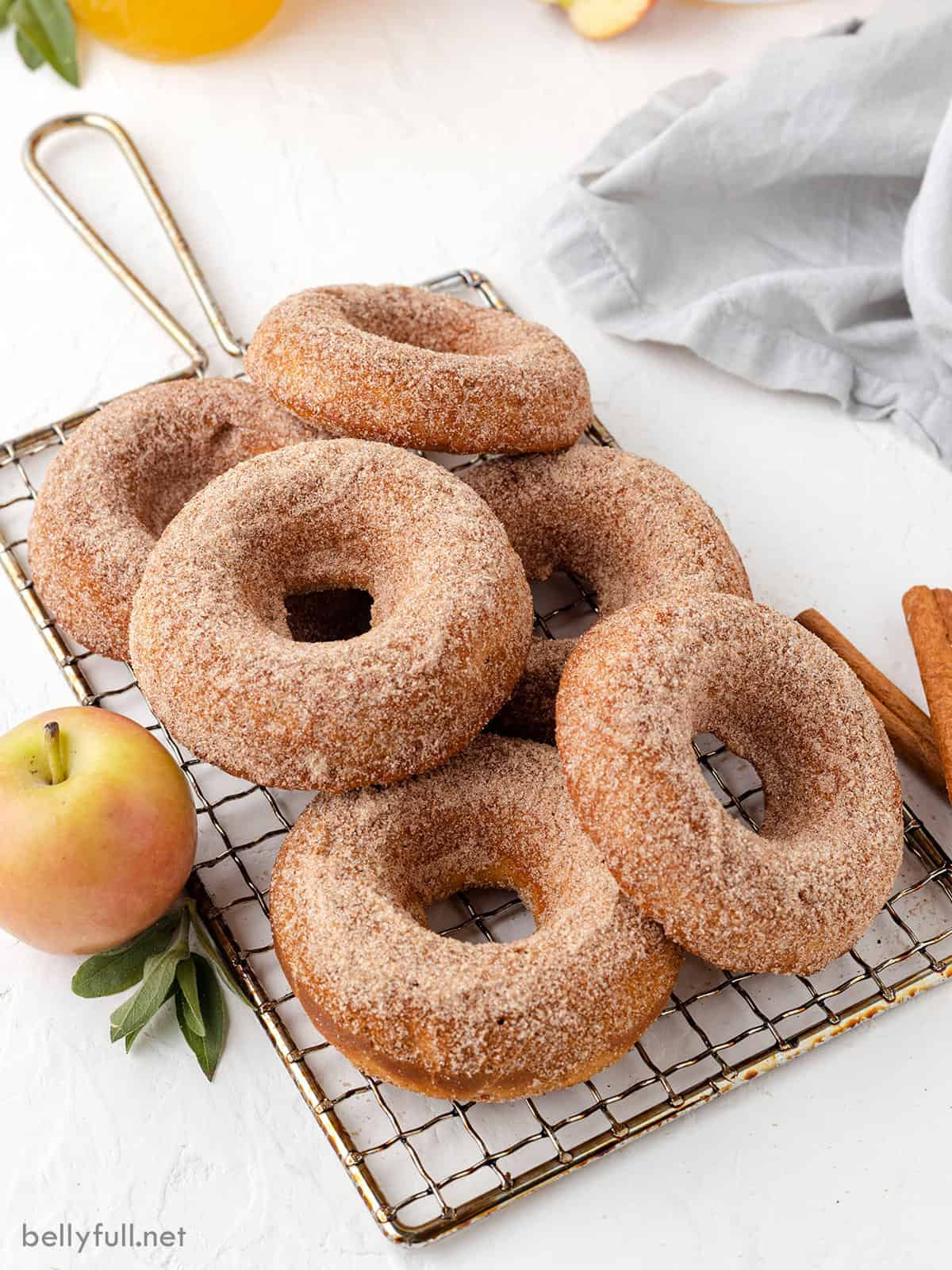 Baked apple cider donuts on a wire rack