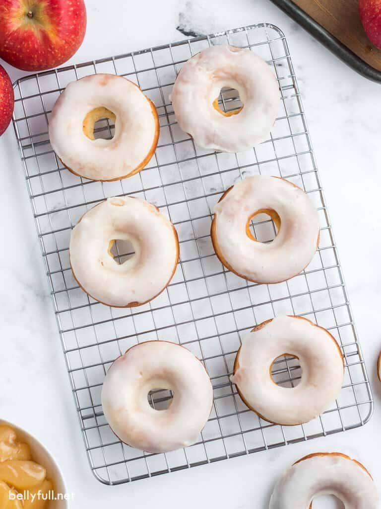 6 glazed donuts on wire rack