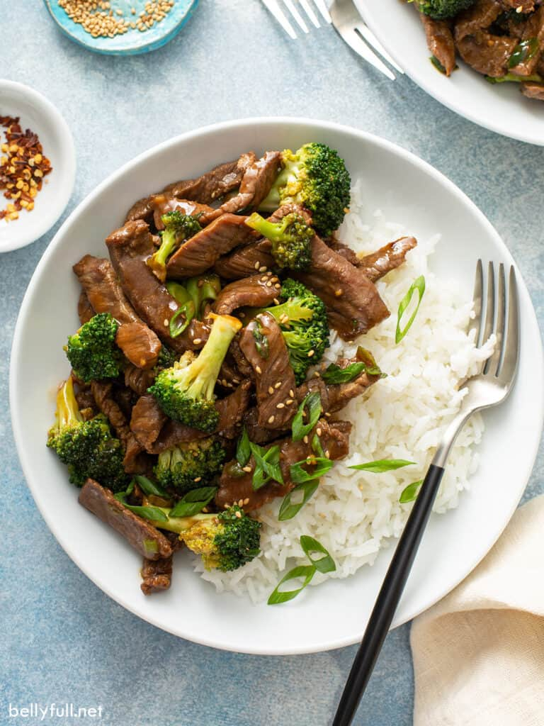 overhead beef stir fry with broccoli on top of white rice