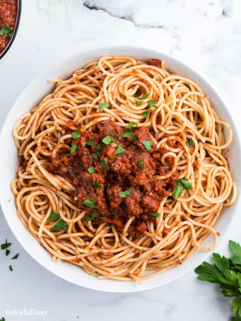 bowl of spaghetti topped with meat sauce