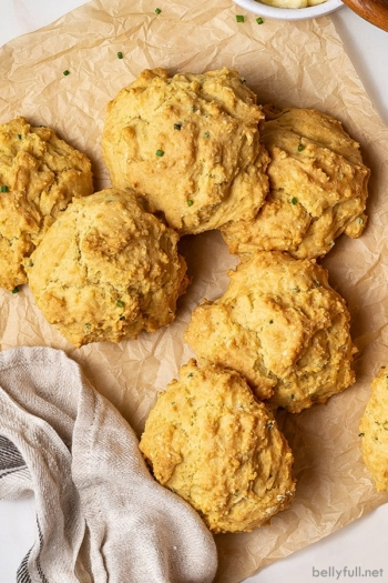 5 golden biscuits piled on brown parchment paper