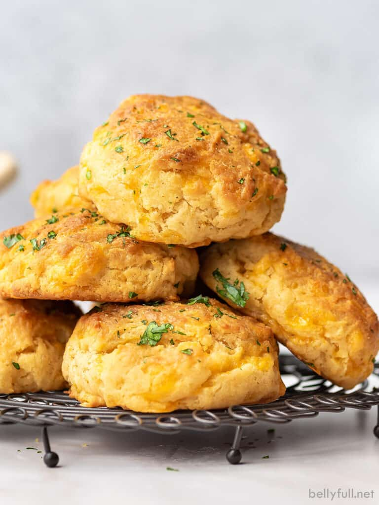 pile of cheddar bay biscuits on cooling rack