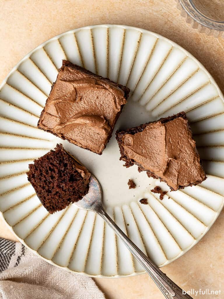 2 sliced squares of chocolate mayonnaise cake on plate with fork