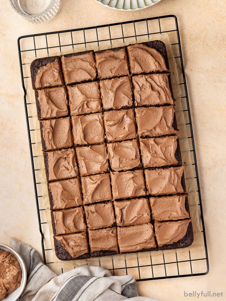 overhead sliced rectangle frosted chocolate mayonnaise cake on wire rack