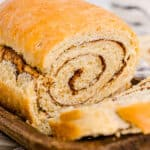 loaf of cinnamon swirl bread with a slice removed