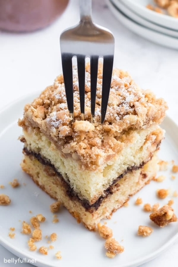 fork inserted into a slice of coffee cake