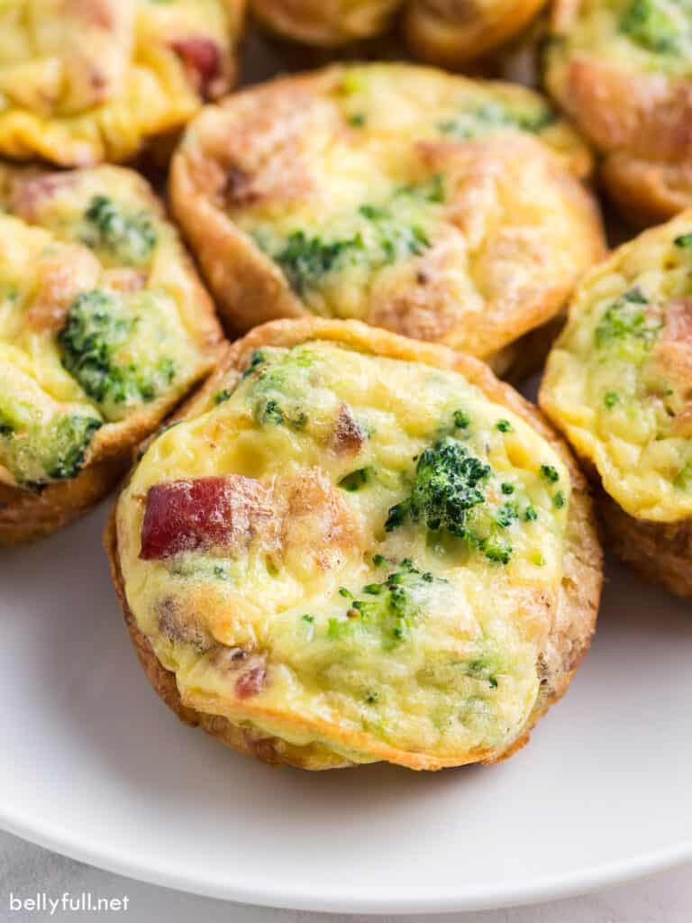 Close up baked egg muffin with broccoli and bacon