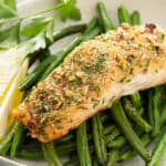 whole baked salmon fillet with bread crumbs and pecans on top