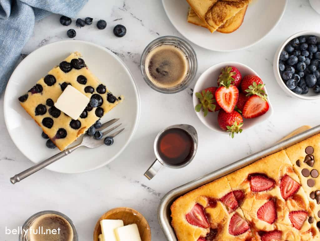 pancakes with a bowl of strawberries and blueberries