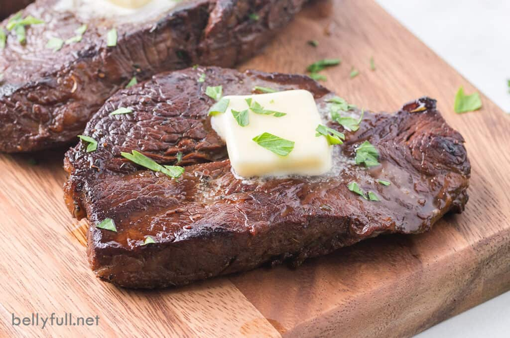 steak in the best steak marinade topped with butter and parsley