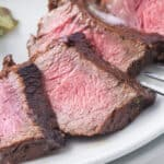 close up sliced steak in easy steak marinade on a plate