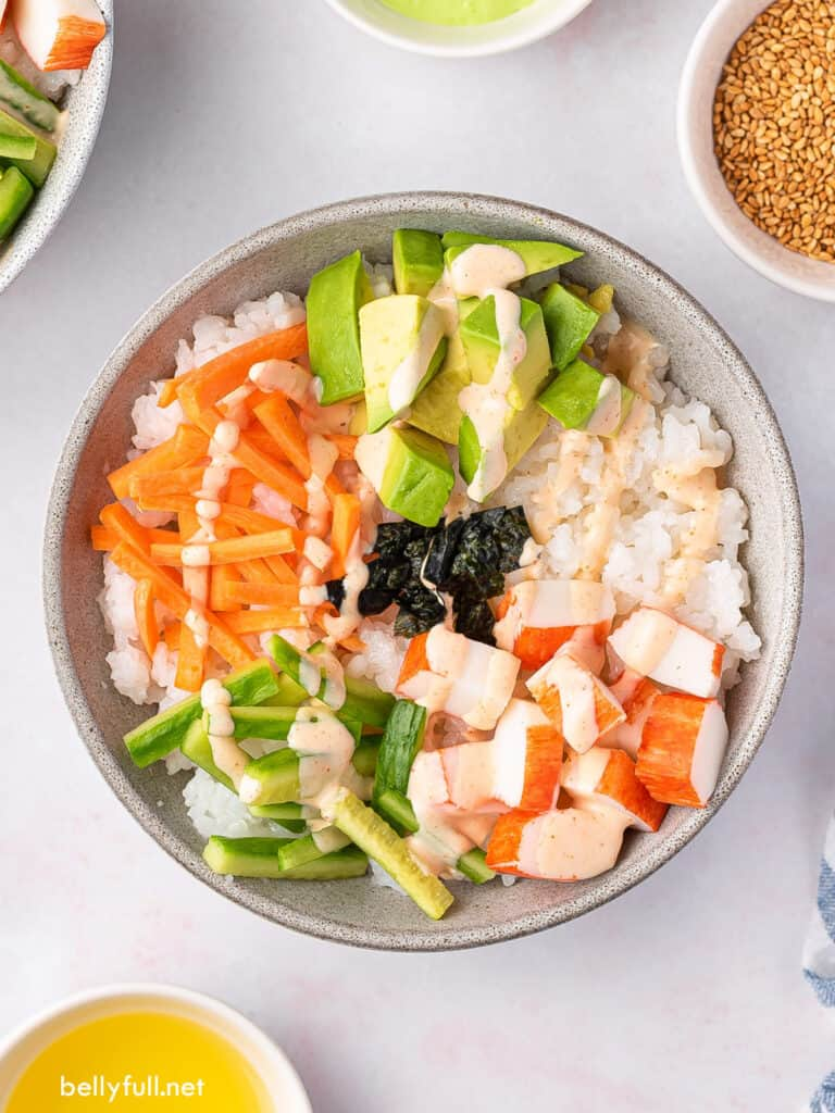 overhead sushi bowl with carrots, cucumber, avocado, and crab
