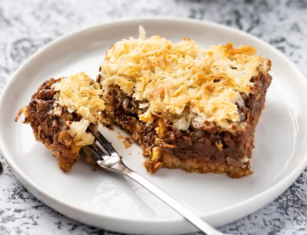 7 layer magic bar on plate with bite taken