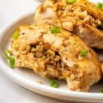 Two stuffed chicken breasts on a plate