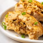 Two rice stuffed chicken breasts on a plate