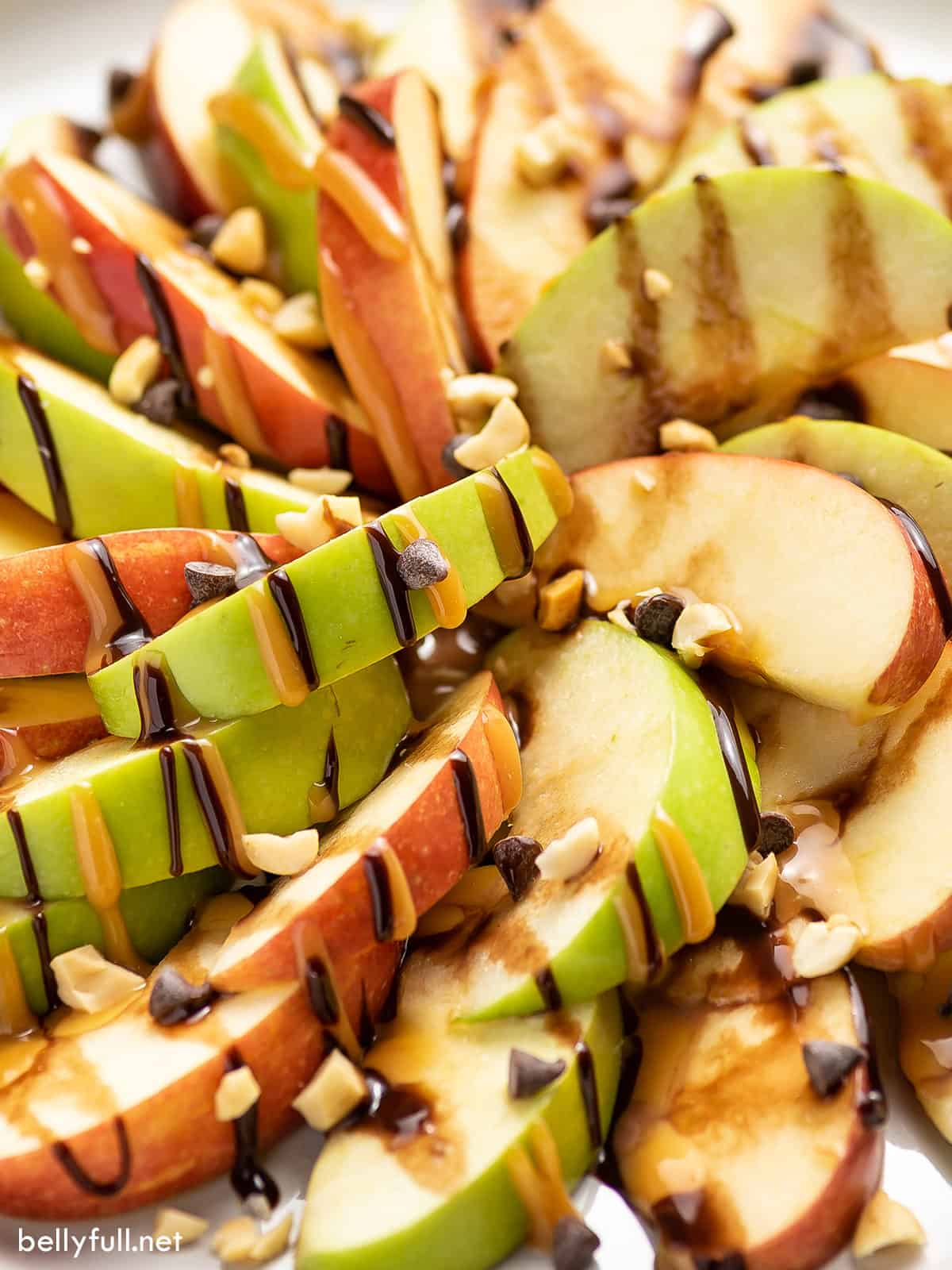 Close-up of caramel apple nachos with hot fudge and caramel sauce drizzle