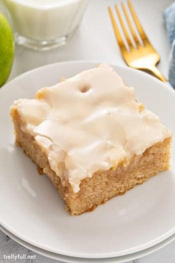 square slice of caramel apple sheet cake on plate