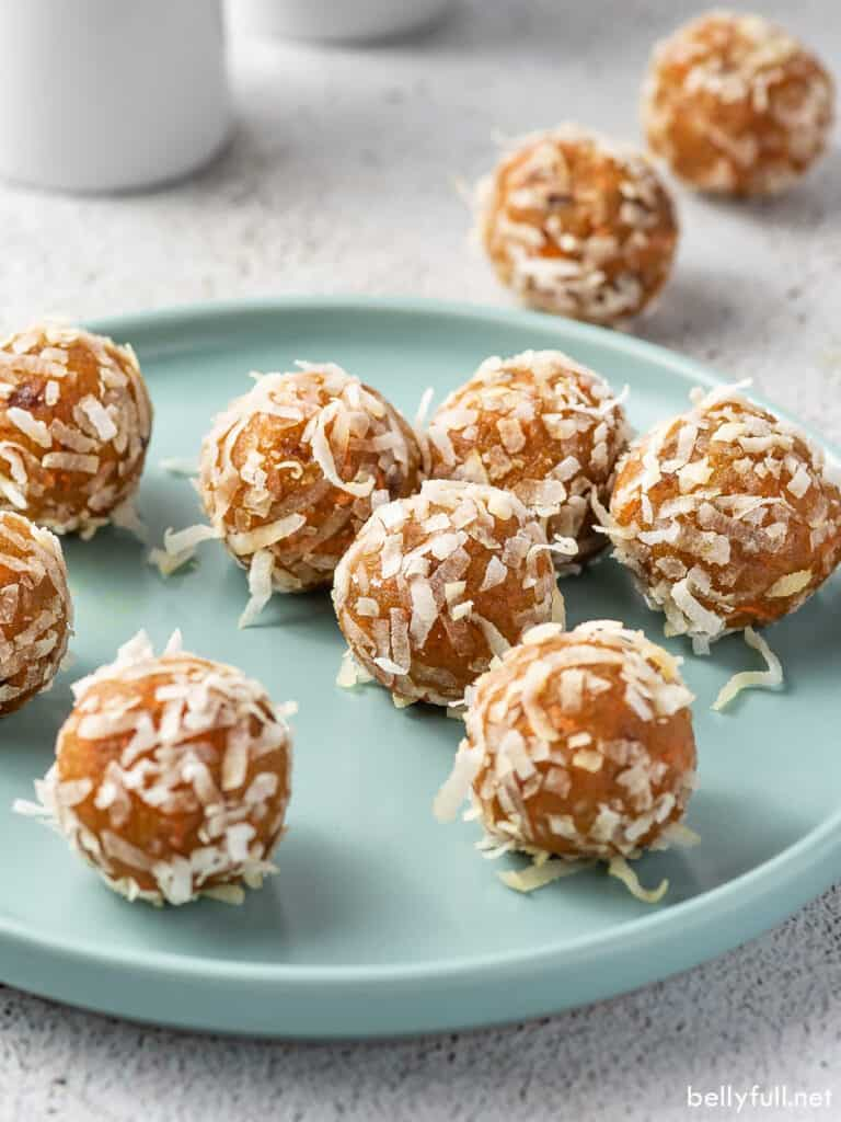 several carrot cake energy bites on a plate